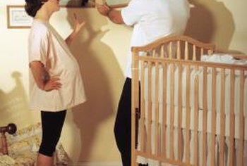 One shortcut is to make a high-water crib skirt that will eventually skim the floor when the mattress is lowered.
