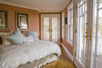 Feng shui principles say never to place the foot of the bed so that it faces a door.