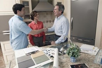 Homeowners consult interior designers for remodeling projects.