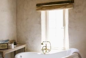 Textured walls can give your bathroom a Western-inspired look.