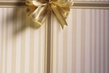 Gift wrap is excellent as a fun and temporary wall covering.