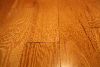 Peel-and-stick wood-look flooring bonds against a clean subfloor.
