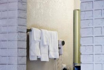 If you want to downplay the exposed brick in your bathroom, painting it is an effective option.