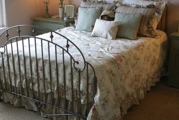 Add curtains that match the bedding on your nickel bed for a finished look.