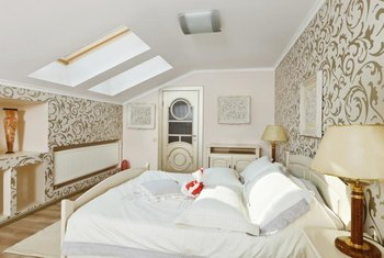 Take advantage of a sloped ceiling by putting the headboard under the highest part.