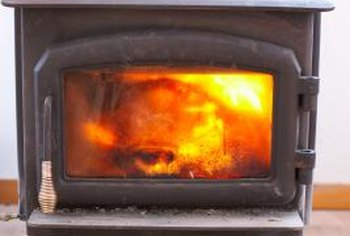 The surfaces of a wood stove get hot enough to cause severe burns.