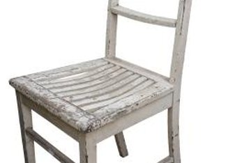 Wood stain over a distressed white chair makes the chair look even older.