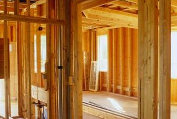 Insulate between the doorjamb and stud frame to stop drafts. & How to Put Insulation Around a Door | Home Guides | SF Gate