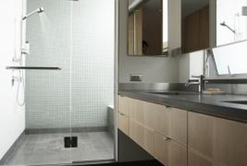 Granite tile showers are high-end and normally only used in master bathrooms.