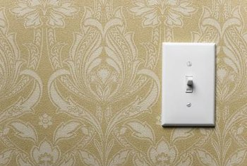 Remove wall plates before covering them with wallpaper.