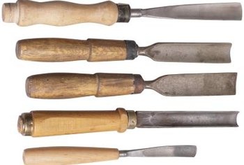 Masonry chisels come in various sizes so you can match them to the angles of the curve.