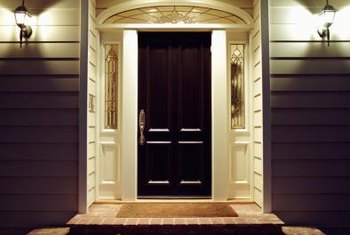 A black door and shutter combination can add gravity to a home.