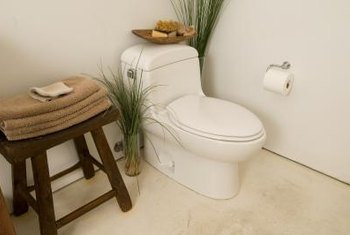 A new plastic oval toilet seat easily updates bathroom decor.