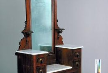 Antique mirror glass typically has at least a few flaws or bubbles.