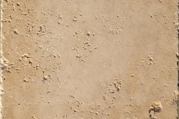 Tumbled travertine has a worn, uneven edge.