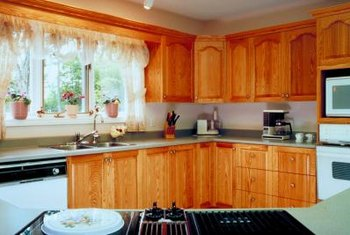 Refresh your stained cabinets with a coat of latex paint.