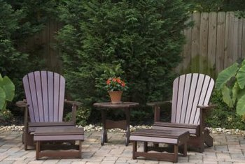 Gravel, trees and clumping plants help mitigate rainwater runoff from a patio.