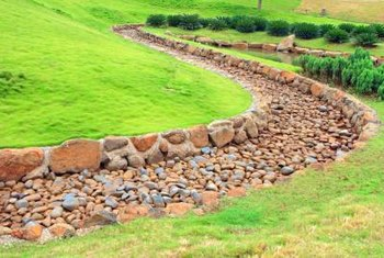 Ensure no rocks are in your way before you mow a lawn.