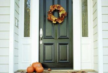 Create a welcoming entrance by redoing the front door with paint and accessories.