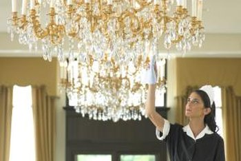 Hang the chandelier so that the bottom suspends at least 7 feet high without a table.