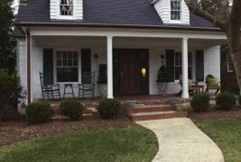 A covered porch can enhance your home's curb appeal, real estate agents suggest.