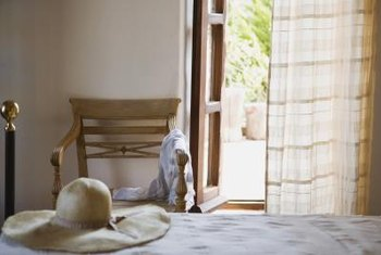 Blend primitive textures with country linens in your master bedroom.