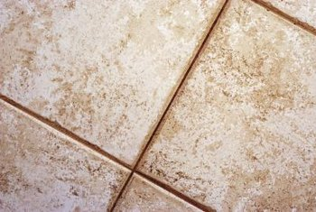 Use an angle grinder when removing grout from tile floors.