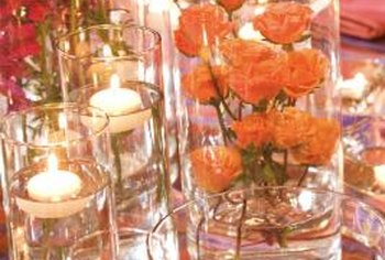 Clear vases, fresh water and floating candles create versatile and elegant table decorations.