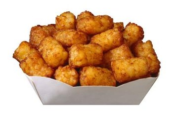 The added fat in tater tots makes them more energy dense.