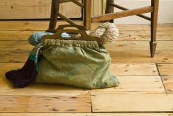 Distressing pine wood flooring, as well as adding stain, can give it a rustic appearance.