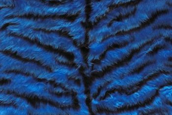 Clean a faux fur blanket at home with a top-loading washing machine.