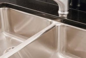 Under-mount sinks are used with tile, granite and marble countertops.
