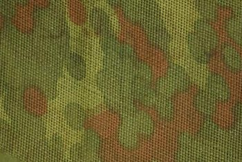 Use camouflage-patterned fabric for window and bed coverings.