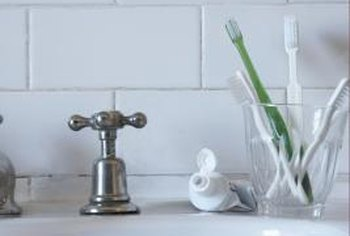 Change your faucet handles for something more modern and appealing.