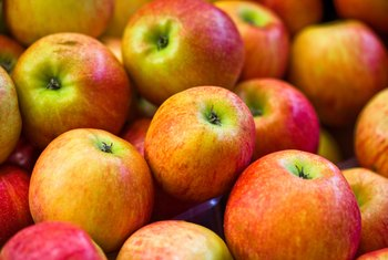 Apples contain fructose, sucrose and glucose sugars.