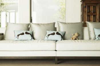 Large pillows soften the back of the sofa while the smaller ones add color.