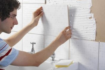 Install big tiles or small on your bathroom wall.