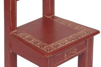 Tracing outlines and drawing simple patterns on wood furniture enhances its rustic style.