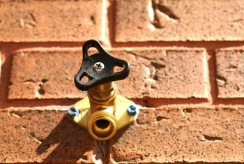Use your outdoor faucet for the water source in a DIY sprinkler system.