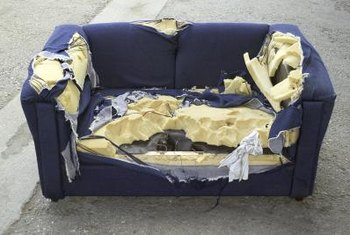 A severely damaged couch is beyond simple sewing repairs, but less extensive holes can be patched.