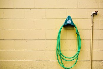 Every garden hose needs a hanger, but it need not be expensive to do the job.