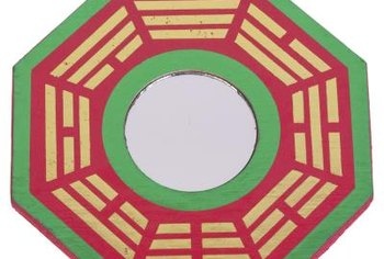 A mirror framed in an eight-sided Pa Kua is a classic Feng Shui cure.