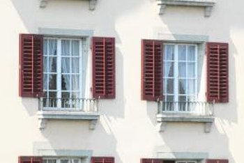 Adding new shutters to a stucco building can draw attention to the windows.