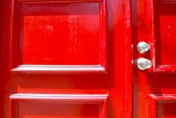 A red entry door offers a warm welcome.