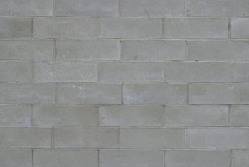 Cover masonry with a vapor barrier to prevent moisture transmission in warm climates.