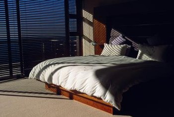 You can make a stylish low-profile slat bed with only basic carpentry skills.