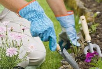 Mixing peat moss in with your flower garden soil can help it stay aerated.