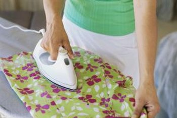 Use an iron to crease clothing and press it flat.