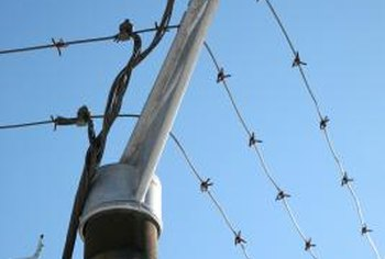 Clicking sounds from electric fences are part of normal operation.