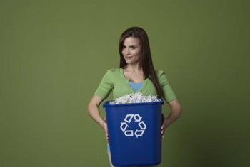 A trash can converts to a recycling bin with the addition of a recycling logo.